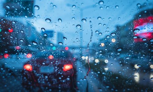 A heavy rain storm, as seen through a car's windshield.
